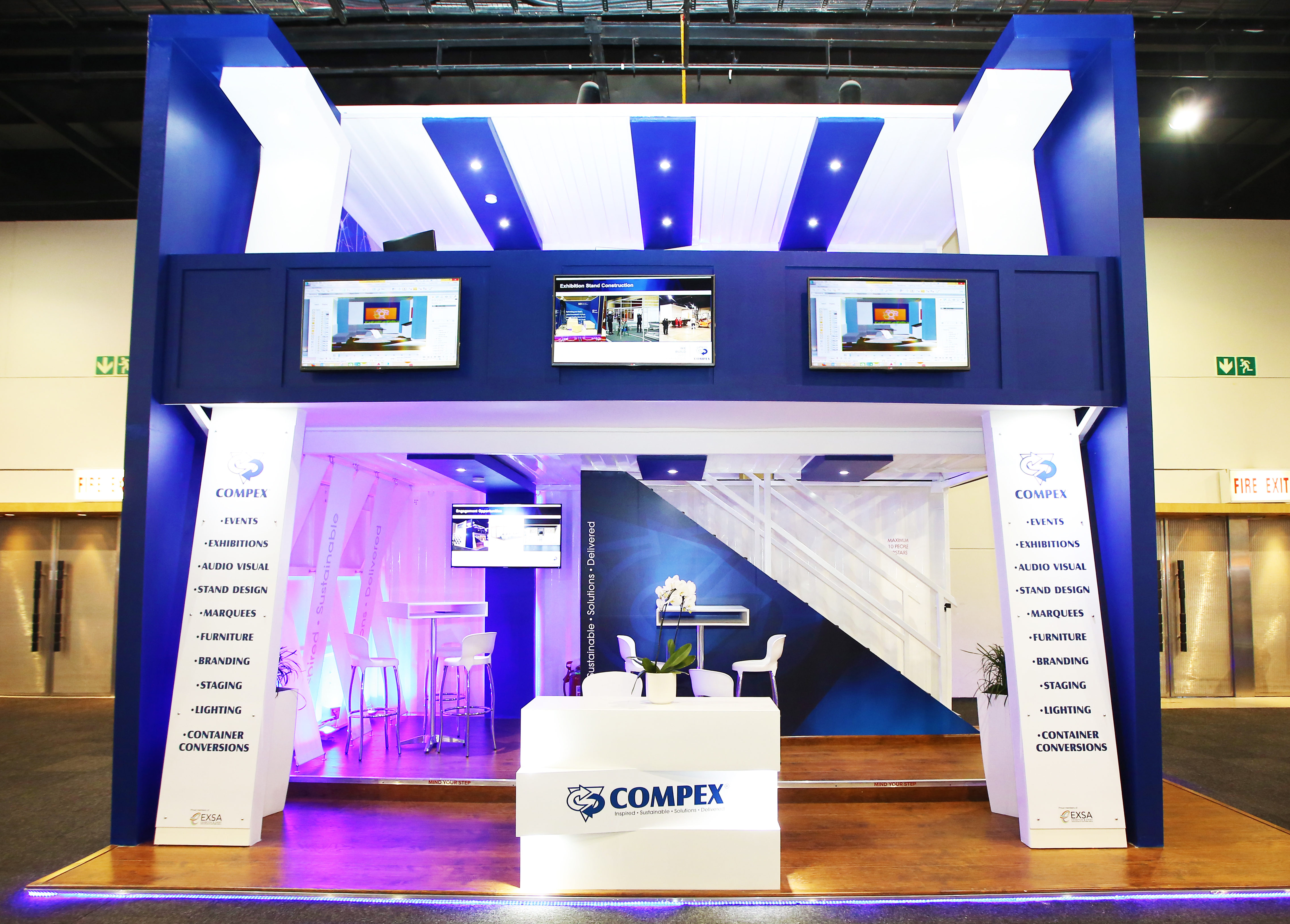 an exhibition stand that has been made using a shipping container